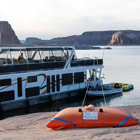 Anchoring Houseboat on Lake Powell with Beach Bags