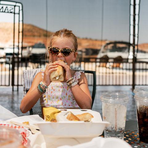 Girl eating at Antelope Point Restaurant at Lake Powell