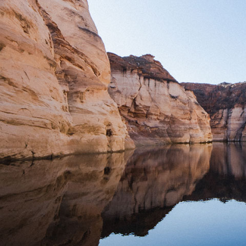 Red rock cliffs and Lake Powell water at Antelope Point Marina
