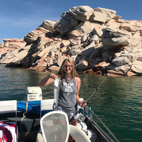 Girl fishing on Lake Powell